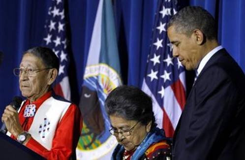 Hartford and Mary Black Eagle and President Barack Obama bow their heads in prayer during the White House Tribal Nations Conference at the Interior Department in Washington on December 2, 2011.