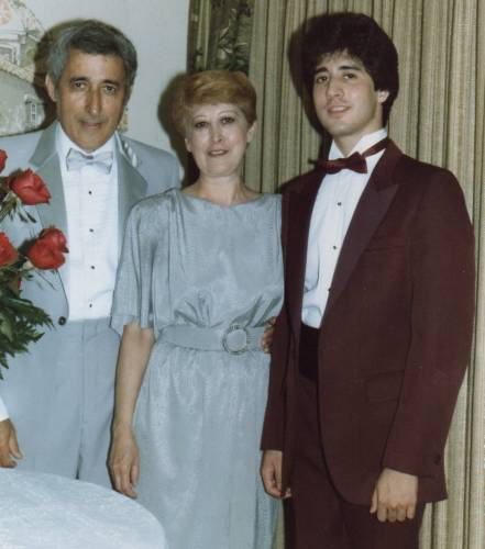 Me with my parents at their 25th wedding anniversary in 1984.