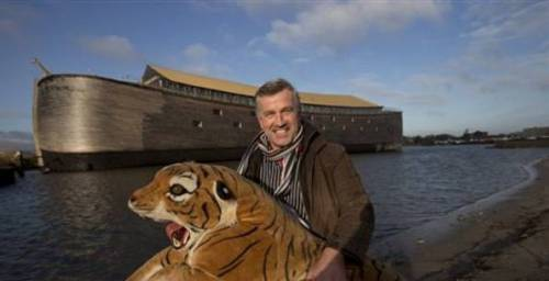 "Huibers with a stuffed tiger and his ""ark"" in the background."