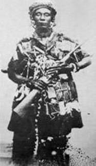 "Yaa Asantewaa in an undated photograph wearing ""batakarikese,"" or ceremonial war dress."