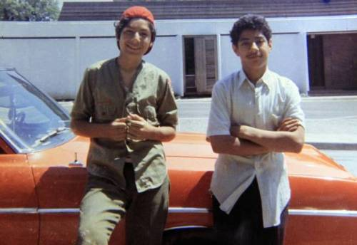 Santos Rodriguez, right, stands with his brother David next to a relative's car just a month before Santos' death.