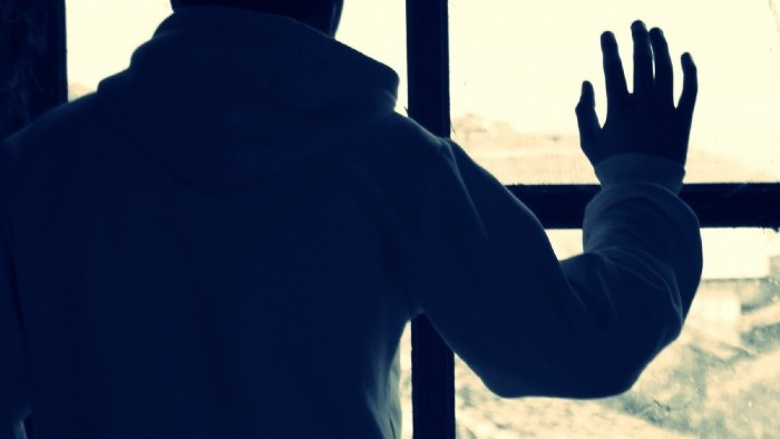 Man-glass-window-back-silhouette-900x1600