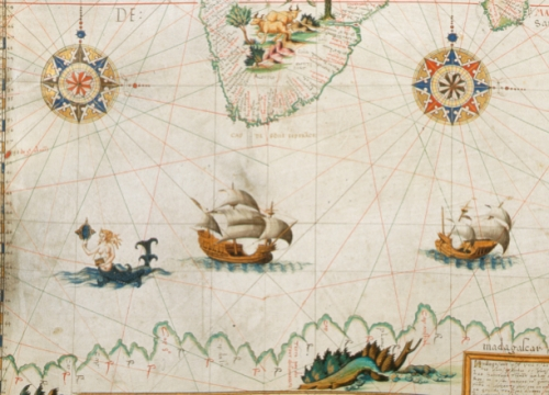 In a classic delineation, a siren admires herself in a mirror while surrounded by ships in the Southern Ocean on Pierre Descelier's map from 1550.  Other monsters can be seen on the nearby lands.