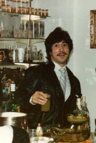 """I commandeered the bar at the home of some long-time family friends on New Year's Eve 1983.  My jacket was faux leather, but the hair was real!  When the hostess asked what speed she should set the blender to mix margaritas, 'whip' or 'puree,' I said, """"Drunk."""""""