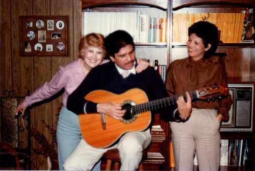 Another New Year's party, with my mother clowning alongside the friends who often entertained us with a guitar and a song.  My mother just turned 81, but the couple left us more than three years ago.