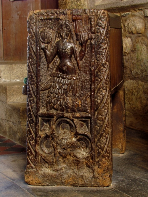 Wood carving of a mermaid on a bench in the Church of St. Senara, in the village of Zennor, West Cornwall, England.
