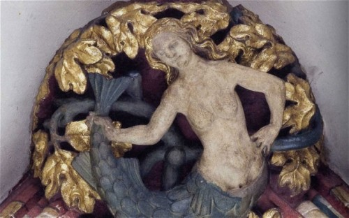 A mermaid on the roof of Exeter Cathedral in Exeter, England, c. 1400.