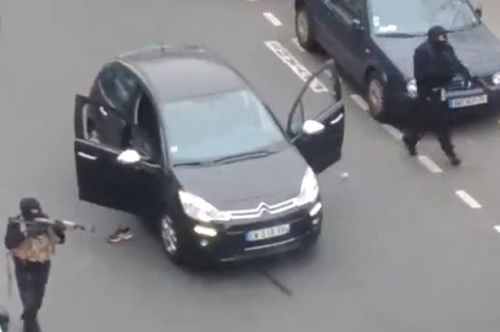 Masked-gunmen-stormed-the-headquarters-of-the-weekly-Charlie-Hebdo-in-Paris