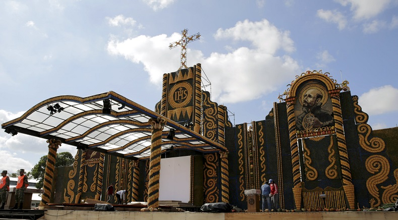 Workers put the finishing touches to an altar, made of corn and pumpkins, where Pope Francis will give the main mass on July 12 during his visit to Paraguay, in Asuncion