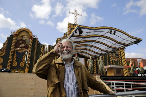 Paraguayan artist Koki Ruiz poses for a picture in front of an altar he built using corn and pumpkins, where Pope Francis will give the main mass on July 12.